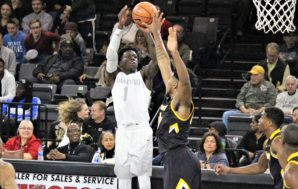 Golden Grizzlies' trio combines for 76 points in 97-86 Towson…
